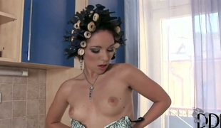 Brunette Kami Nikita touches her knockers in a playful manner
