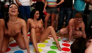 Hot porn stars are playing twister at a party. They are on top of each other, making love and having group sex. See the ladies get off on each other here.