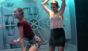 Cuties dancing in a shower on stage at a wild nightclub party