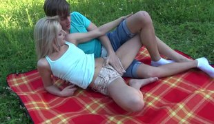 While out on a picnic this pair fucks on their blanket
