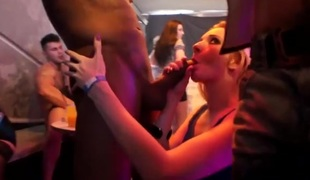 Ladies lick whipped cream off a male stripper