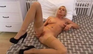 Milf love tunnel is flawless as the hot blonde rubs it