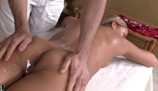 Christen acquires a full body massage by huge cocks in an MMF threesome act