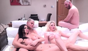Golden-haired and brunette nymphos join a hung stud for a torrid 3some