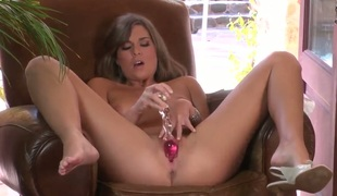 Adrienne Manning with smooth pussy can not live a day without toying her pussy hole