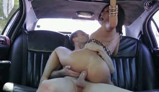 Hawt woman is in the back of her car. She can stretch and bow her body in amazing ways. She is getting an anal gangbang and her pussy is being fingered in this video.
