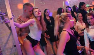 Wild ladies watch the hot male strippers dancing at the club