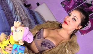Pantyhose girl trampling a stuffed toy with her pretty feet