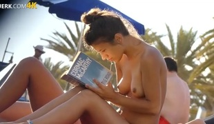 Cute topless beauties reading books on the beach