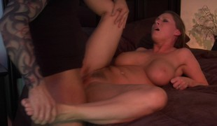 Breasty dark brown gets her shaved cum-hole licked and fucked deep on the sofa