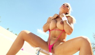 Blonde enchantress in a bikini receives and gives head before they fuck