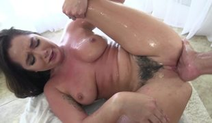 A brunette hair with hair on her pussy is upside down while fucking