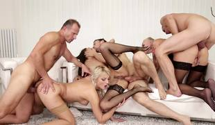 Angels are doing an orgy with some men at a swingers party
