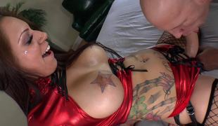A large a-hole slut with tattoos and a strap on is fucking her paramour