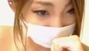 Hot Oriental webcam model zooms camera betwixt her legs