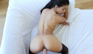 Breasty Latina babe bends over perfectly