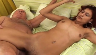 Sizzling red haired babe with large boobs fucks an old man