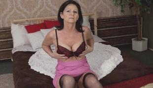 Sheer black stockings on a masturbating aged brunette