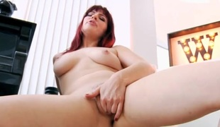 Solo redhead Jessica Ryan plays with her pussy