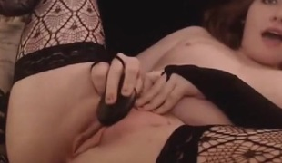 Large booty cam redhead swallows a sex toy