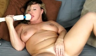 Magic Wand and a bulky milf masturbating