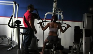 Coach helps a babe work out on the equipment before he nails her
