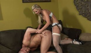A blonde dominatrix penetrates her slave with her strap on