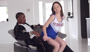 Hot cheerleader sits her small ass on a black fellows crotch