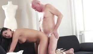 Coco de Mal bouncing on top of an old mans palpitating cock