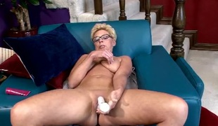 Spinning dildo penetrates a wet older slit