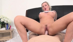 Tattooed blonde with perfect boobs and arse goes wild for a long stick