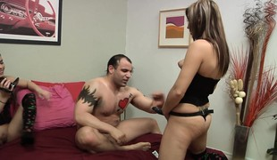 Shana and ally use a strapon to fuck Rick in the ass and blow him