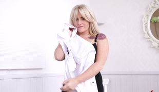 Voluptuous MILF Lizzie stripping seductively in front of camera