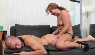 A girl is punishing her man by fucking him with a large thong on