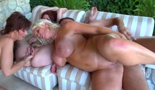 Three horny milfs with sizable wobblers and large asses are doing anal in a group sex video. The guy is really lucky to have 3 sweethearts to choose from. He fills 'em with cum.