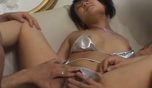Shiny silver bikini on the lovely Japanese cocksucker