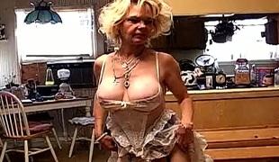 Hot and hairy mature blonde masturbates in nylons