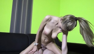 Sexy skinny blonde with large hooters Penelope has a passion for cock
